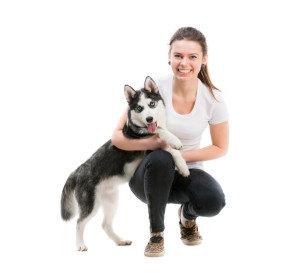 portrait of happy girl in white t-shirt isolated o and husky dog